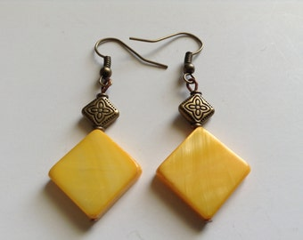 Yellow mother of pearl with brass accent bead (item #204)