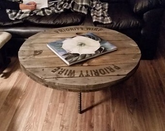 Reclaimed industrial authentic round spool top coffee table top on salvaged smooth brushed narrow rebar tripod solid steel iron legs
