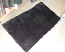 Handmade black leather rug from rabbit pelts