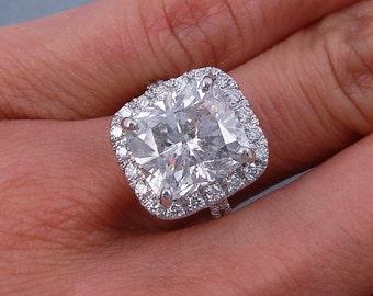Glamorous 6.78 ctw Cushion cut diamond ring with a 6.04 ct F/SI2 Clarity Enhanced Cushion cut diamond
