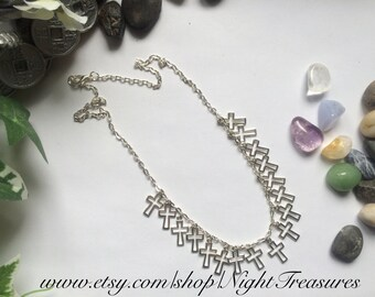 Crosses neckclace on a silver chain of 18''
