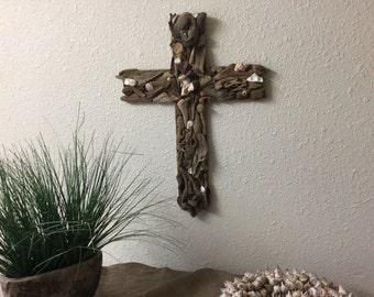 Beautiful driftwood and shell cross