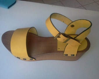 wedge socket in wood and leather clogs
