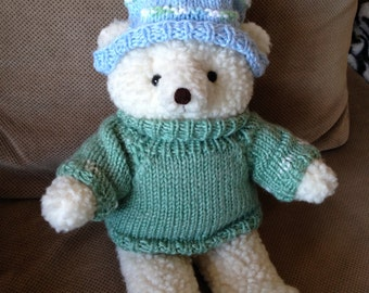 White bear with sweater and hat