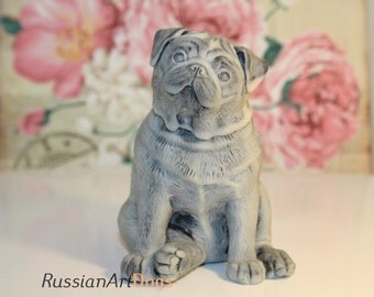 Realistic figurine Pug of the marble chips