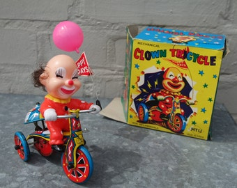 """Vintage 50' mechanical toy: """"a clown on a tricycle"""""""