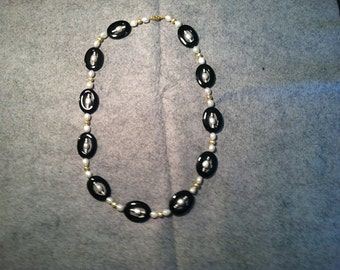 26 in Neckless with Black Ovals, White Fresh Water Pearls, and Gold beads