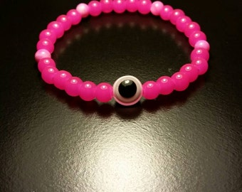 Bright pink glass beads with pink evil eye