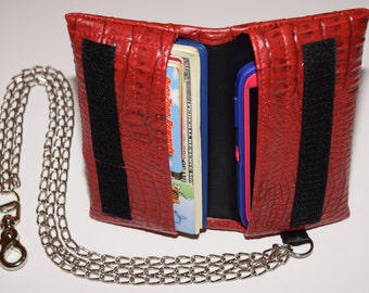Handcrafted, multi-use, universal fit cell phone and wallet with chains. Made for a variety of cell phones with our without an otterbox.