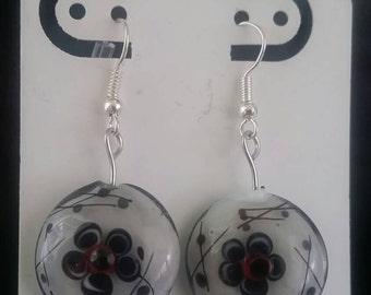 White, black and red flower earrings