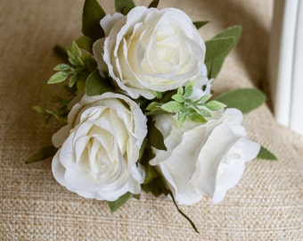Ivory silk wedding jacket corsage. Made from artificial roses and greenery.