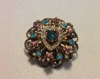A vintage Coro multi layered colorful pin