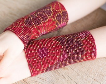 Hand-knitted red color wrist warmers decorated with pink/red/purple/yellow beads
