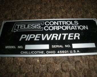 Telesis Control Corp,OH,Pipewriter-product SN plate.Metal Advertising.Black,silver.Free Shipping.Lots of older goods at ProductsOverTime.See
