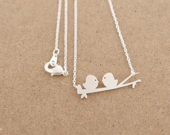 Silver love birds on a branch pendant necklace