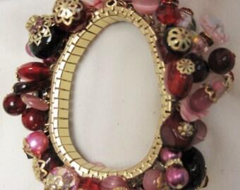 Spandex Bracelet # 79 by Tricia large Rose Quartz, Reds, Black,on Gold