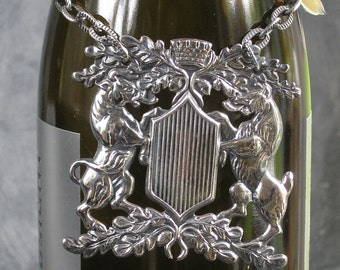 Antique silver plate bottle tag 2 lions engaged  on a shield with a castle/turret