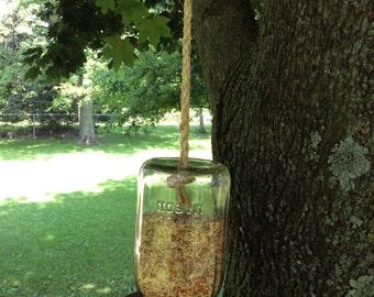 Hanging bird feeder from antique Mason jar