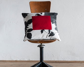 Floral pillow with red square