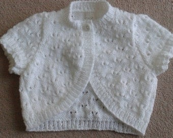 hand knitted baby or childs bolero made to order in your choice of colour and size. Prices may vary