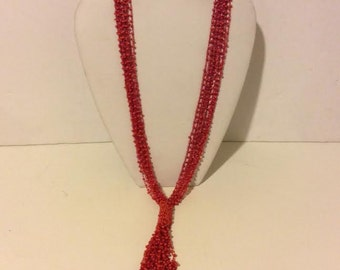 Long red beaded lariat necklace
