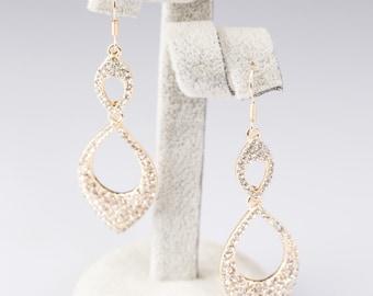 Gold tone tear drop dangle loop earrings