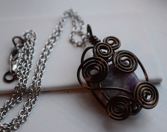 Swirled, wrapped purple stone necklace