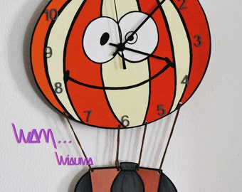 clock hot air balloon with a beautiful smile