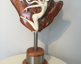 Porcelain sculpture . Two minds one heart