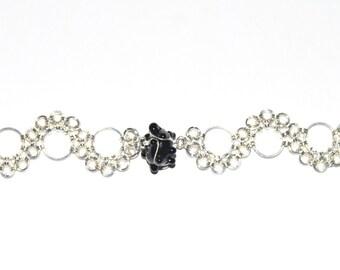 Jump ring and lamp-work black glass bead bracelet