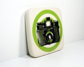 tile with a Holga camera on a leaf bullseye, made to order.