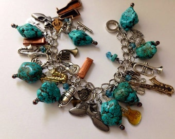 Turquoise charm bracelet  music musician instrument harmonica mouth horn sax french horn dance band  piano band microphone shoes charms