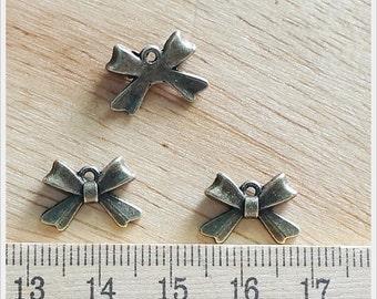 10 pcs Antique Brass Mini Tiny Bow Ribbon Charm Pendant