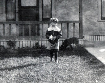 vintage photo 1903 Little Sweet boy holds early Rubiks Cube like toy in Hand by House w Dog