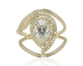 Pear cut Moissanite Egyptian Eye Engagement Ring with Pave Diamond Halo and Unique Split Shank in 14k Yellow Gold – LS4290