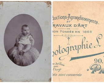 Vintage Antique 1900 French photographic image baby seating on a fur cabinet photography