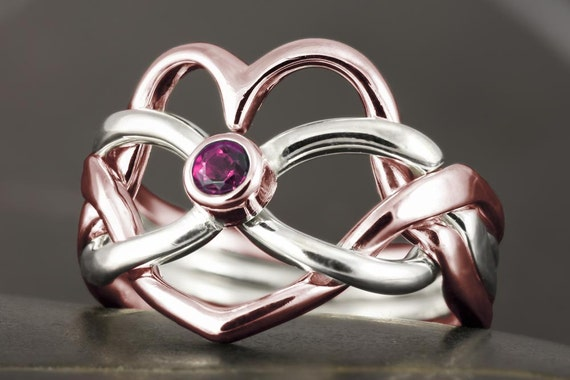 Solid gold infinity knot heart shape puzzle ring with natural pink tourmaline