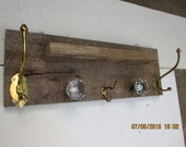 Barn wood Coat and Hat Rack made with antique glass knobs and coat hooks