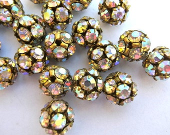 2 Vintage SWAROVSKI BEADS 11mm, AB crystals in brass setting creating ball bead