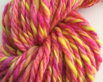 Bright pink and chartreuse bulky handspun yarn