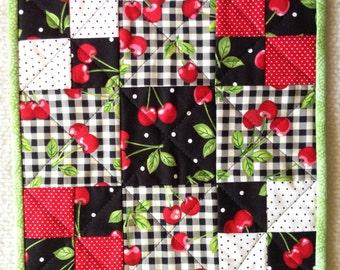 Cherry mug rug mini patchwork quilt black white with red cherries