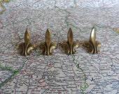 SALE! 4 small mid century fleur de lis brass metal knobs