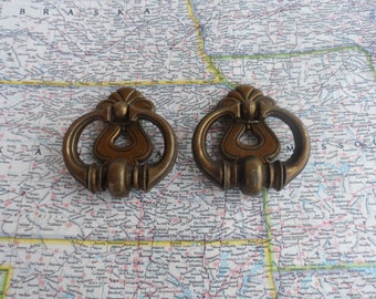 SALE! 2 vintage round open brass metal pull handles with curvy trimplates