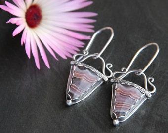agua nueva sterling silver metalwork earrings