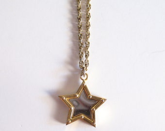 PIERRE CARDIN gold mirrored star necklace
