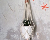 Wall plant hanger in macrame,  natural cotton cord and copper beads.