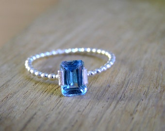 Sky blue topaz granulated sterling silver ring.