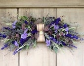 Dried flower swag for your home or wedding.  With bulap and vintage button. In shade of lavender and Violet.