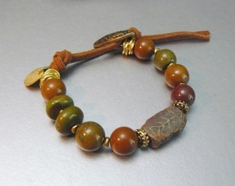 Natural Turquoise Beaded Bracelet with Carved Fish Focal - Soft Tan Leather clasp with Antique Button - Gold Coin Charms
