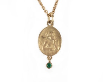 golden guardian angel with emerald, sapphire, ruby